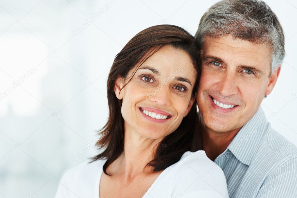 Closeup portrait of a happy mature couple together over a background — Stok fotoğraf #3301887
