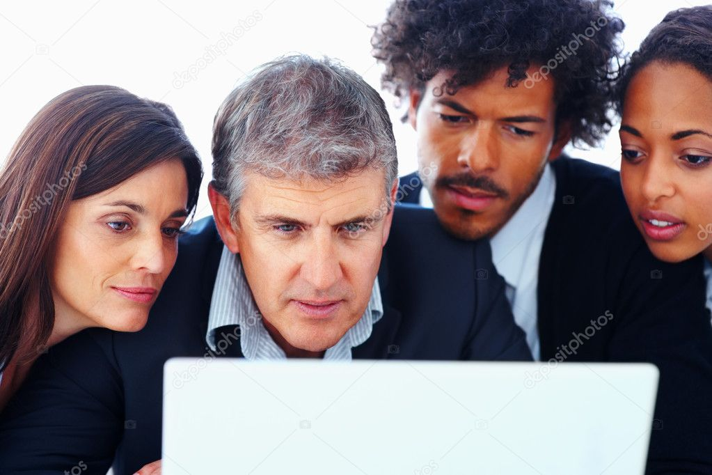 Portrait of a business team working together on a laptop — Stock Photo #3302252