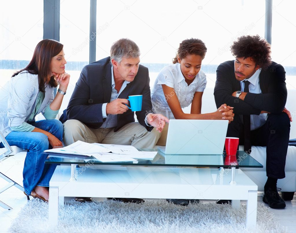 Portrait of a business team sitting together and working on a laptop — Stock Photo #3302264