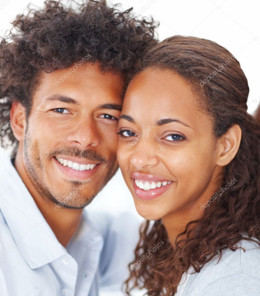 Closeup portrait of a young beautiful attractive African couple smiling over a background — ストック写真 #3302745