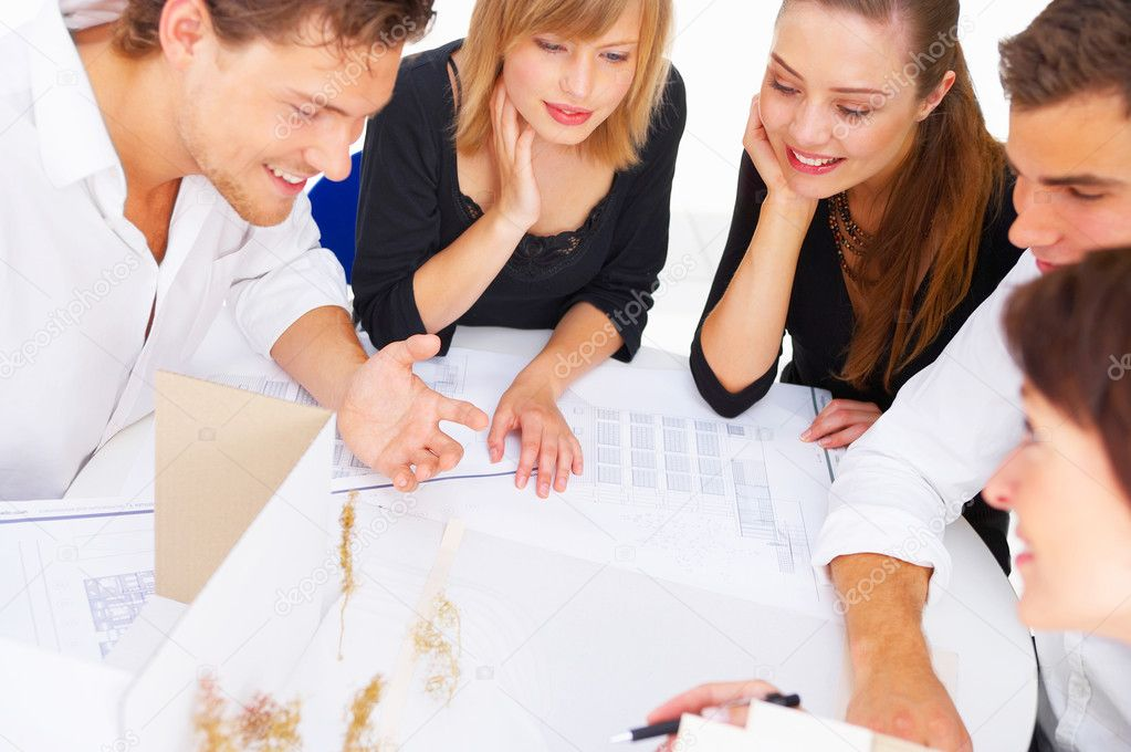 A group of architects discussing the plans for a new building — Stock Photo #3313198