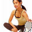 Sportive young woman doing stretching exercise looking away over - Stockfoto