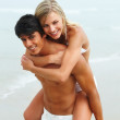 Royalty-Free Stock Photo: Passionate young boyfriend piggybacking her sexy girlfriend on t