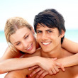 Portrait of a couple enjoying their vacations on the beach - Stock Photo