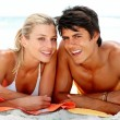 Cute young guy and girl enjoying their summer vacation together - Stock Photo