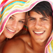 Happy young couple with a towel on their heads - Stock Photo