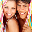 Royalty-Free Stock Photo: Lovely young couple with towel over their head