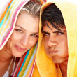 Royalty-Free Stock Photo: Happy young couple making a funny face with a towel over their h