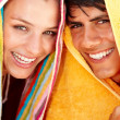 Royalty-Free Stock Photo: Charming young woman and man with a towel over their heads