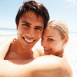 Royalty-Free Stock Photo: Closeup of a cute young couple romancing at the shore