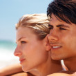 Royalty-Free Stock Photo: Young couple in a contemplative mood at the shore