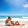 Royalty-Free Stock Photo: Lovely couple relaxing together at the sea shore