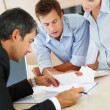 Business seriously discussing on certain business concern - Stock Photo