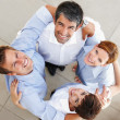Royalty-Free Stock Photo: Successful business forming a huddle