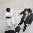 Upward view of a business team involved in a serious discussion - Stock Photo