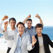 Royalty-Free Stock Photo: Portrait of a group of excited business colleagues with their ha