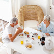 Royalty-Free Stock Photo: A healthy senior couple having breakfast in the morning