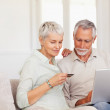 Royalty-Free Stock Photo: Senior couple shopping from the net at home with their credit ca