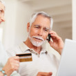 Royalty-Free Stock Photo: Senior couple shopping from the net with their credit card