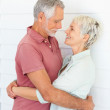 Royalty-Free Stock Photo: Happy elderly couple embracing eachother