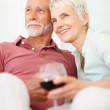 Royalty-Free Stock Photo: Cute couple celebrating retirement with a glass of wine