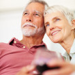 Royalty-Free Stock Photo: Charming senior couple imaging deep into their future