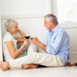 Royalty-Free Stock Photo: Mature couple enjoying a glass of wine at their home