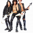 Full length portrait of rockstars with guitars, posing over whit - Stock Photo