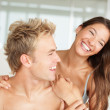 Couple enjoying themselves in bed in the morning - Stock Photo