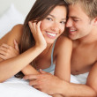 Royalty-Free Stock Photo: Happy intimate couple having fun in bed