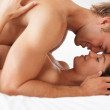 Sex: Passionate married couple enjoying in bed - Stock Photo