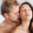 Married young couple during the act of sex at home - Stock Photo