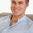 A confident smart male smiling confidently - Stock Photo