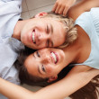 Royalty-Free Stock Photo: Charming couple lying on the floor, enjoying themselves