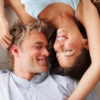Royalty-Free Stock Photo: Happy young couple in love lying on the floor