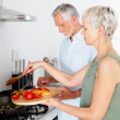 Royalty-Free Stock Photo: Portrait of an elderly couple cooking food together