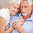 Portrait of a sweet elderly couple in love - Stock Photo