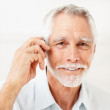 Royalty-Free Stock Photo: A smart old man communicating using cellular phone