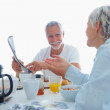 Royalty-Free Stock Photo: Senior couple having breakfast together