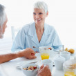 Royalty-Free Stock Photo: Happy senior couple indulging in a healthy breakfast
