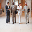 Royalty-Free Stock Photo: Group of business walking through the hallway