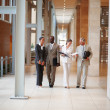 Royalty-Free Stock Photo: Team of busy business walking through the hallway