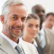 Royalty-Free Stock Photo: Business man with his colleagues at the back