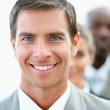 Royalty-Free Stock Photo: Closeup of a happy young business man with his colleagues at his