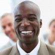 Royalty-Free Stock Photo: A laughing African American business man with colleagues standin