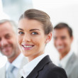 Blur image of a cheerful business woman with her staff standing - Stock Photo