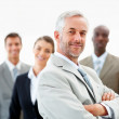 Royalty-Free Stock Photo: Confident senior business man with team at the back