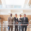Royalty-Free Stock Photo: Happy business colleagues standing by a railing