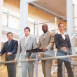 Royalty-Free Stock Photo: Successful business team standing by a railing