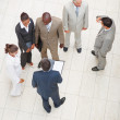 Royalty-Free Stock Photo: Upward view of a team of business colleagues standing together